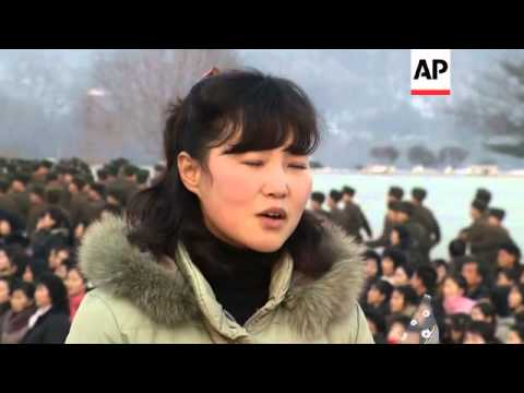 Floral tributes left at statue of Kim Jong Il a day before the 2nd anniversary of his death