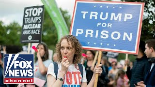 Anti-Trump protesters gather outside Buckingham Palace during Trump's UK visit