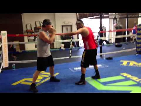 Amateur boxer Phil Rosen working on coordinating head and foot movement with blocking