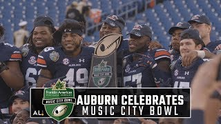 Auburn celebrates their Music City Bowl victory