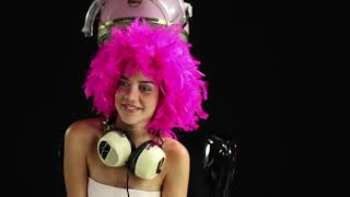 Cool blonde girl dances under a retro pink salon hairdrier - Disco House Music