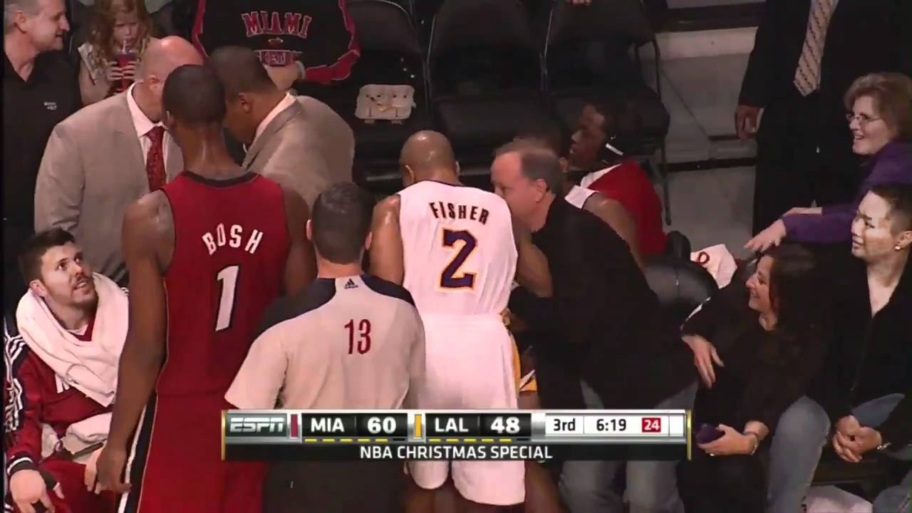 Ron Artest Dives Into The Miami Heat Bench