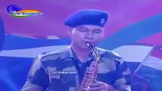 indian soldier playing saxophone