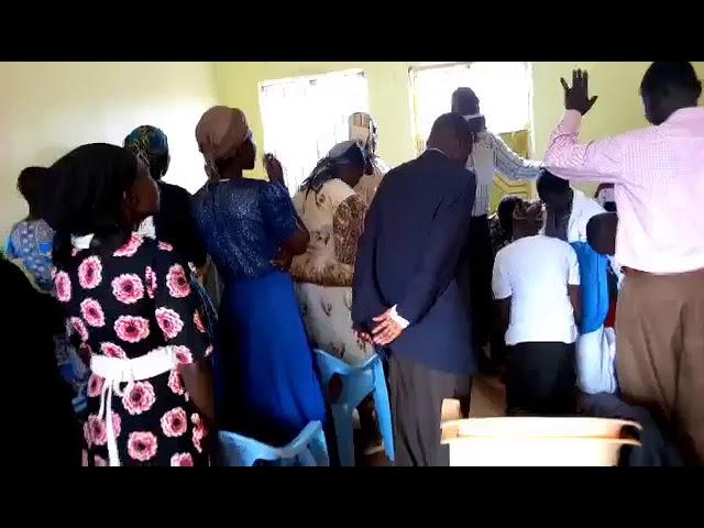 Praying for Brother Josephat WFF Moi's Bridge Kenya 9-2-2018