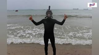 Wear adults one-piece full face snorkel mask with go pro mount R10G at the seaside