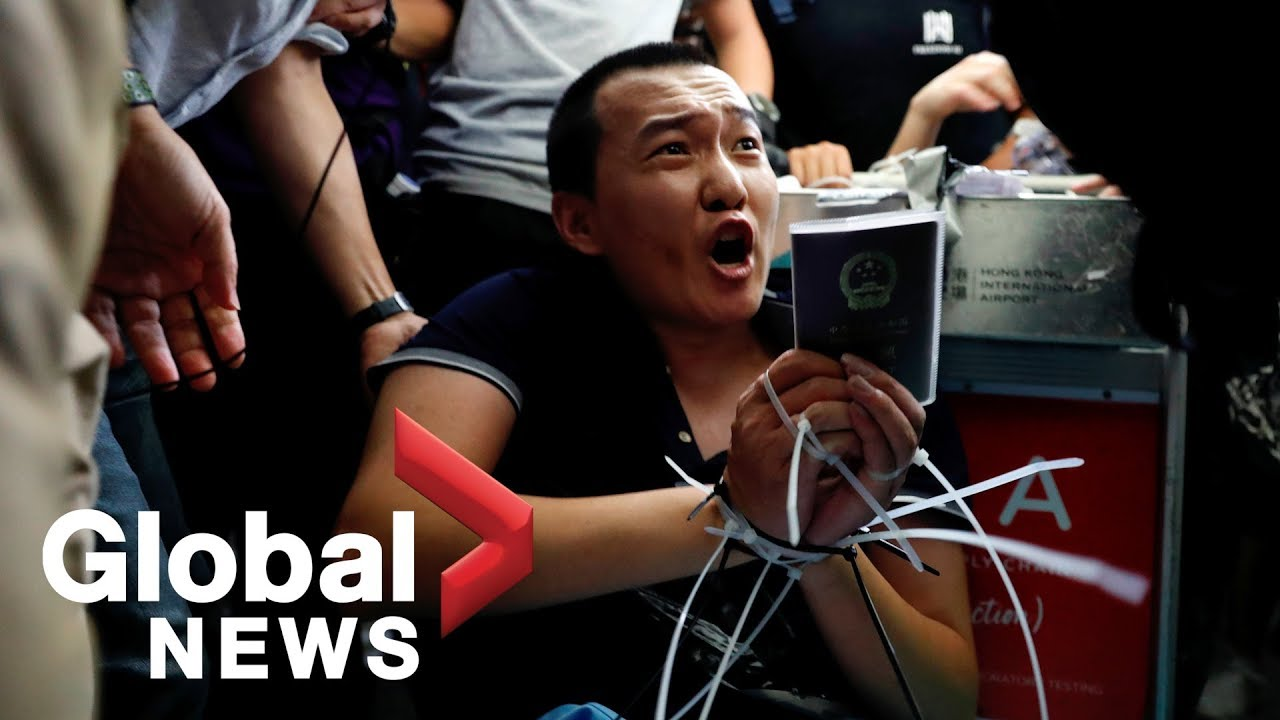 Hong Kong airport chaos: Protesters tie up, interrogate man accused of being undercover police