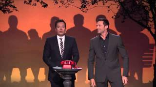 Phone booth with Hugh jackman and shaquille o,neal