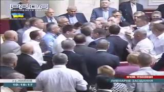 Kiev, Ukraine, 23.7.2014: Communist party leader Petro Symonenko attacked at last day in parliament