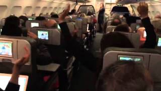Plane Full of Patriots Fans Watching Game On TVs React To Team