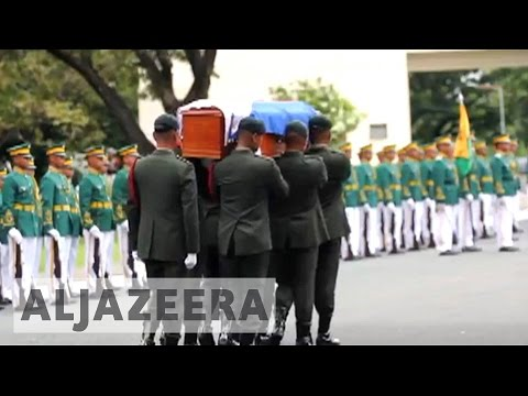 Philippines former leader Marcos buried with honours