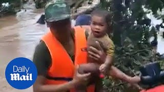 Baby boy saved from dam disaster by Thai cave rescue volunteers