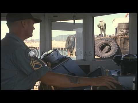 Army tugboat attaches to a barge at a harbor in Vietam. HD Stock Footage