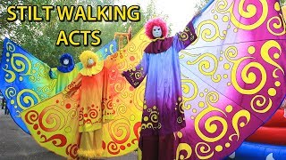 "Stilts ""roaming the show"" on the streets. stilt-walkers on the streets"