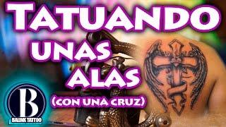 Tatuaje en la espalda (cruz rodeada con alas) - Balink Tattoo Mx