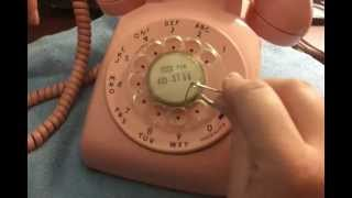 How to Remove a Plastic Finger Wheel Dial from a Rotary Phone