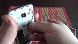 how to Insert a Micro SIM Card into HTC One