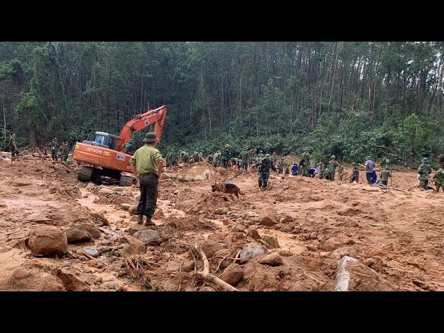 Search underway for 11 Vietnamese army personnel buried in landslide