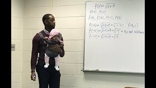 College professor holds student's daughter during class so father can take notes