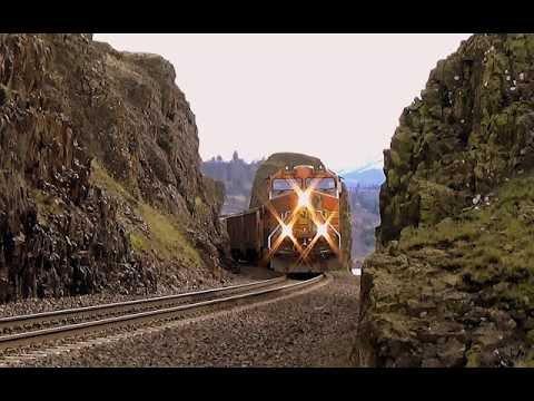 BNSF Diesel triplets lead a coal hopper rake through basalt cuttings along Columbia river gorge