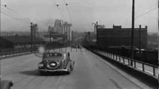 1930s and 1940s automobiles cross Market Street Bridge in Youngstown Ohio, United...HD Stock Footage