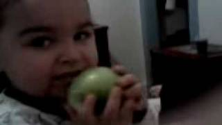 Baby eating a sour apple!