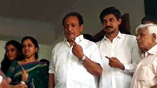 Father-son duo Krishnappa and Priya Krishna cast their votes