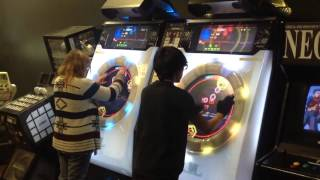 customers playing maimai in our arcade game nest arcade las vegas