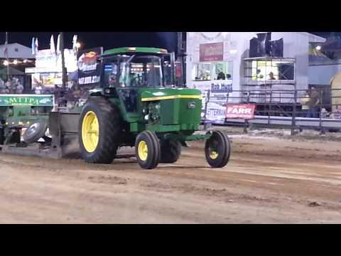 4430 John Deere pulling 13000 field stock