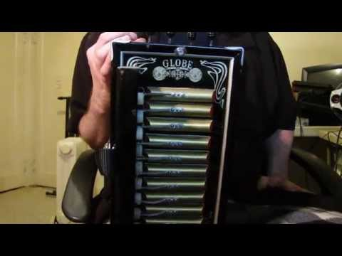 Presentation and play of a Globe Gold Medal Accordeon  (from early 1900's)