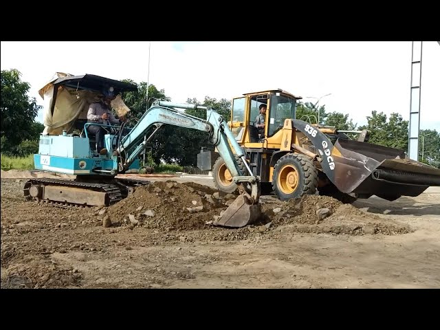Mini Excavator Working With Loader