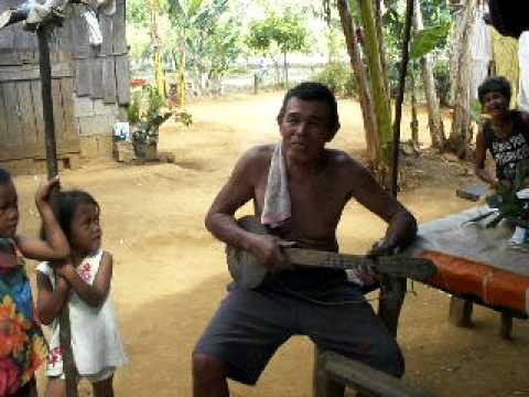 man in sibuyan playing his home made guitar