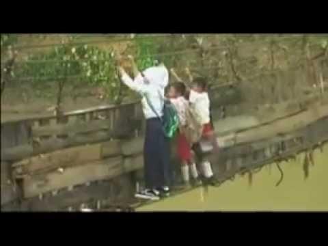children go to school across the broken bridge