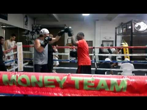Amateur boxer Phil Rosen working mitts with trainer Jazzy Jeff Mayweather the Doctor of Doom