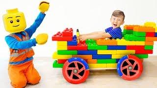 Senya and Daddy Making a car of Coloured Blocks.