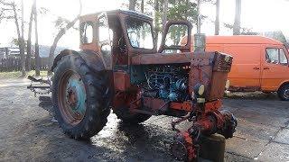 Ремонт трактора Т-40 АМ ч № 6 , зливаємо масло з агрегатів.