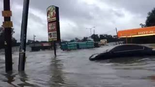 Men Watch as Semi Truck Plows Through Flood