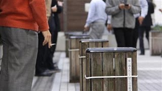 Japan Health Ministry Officials Enjoy a Smoke