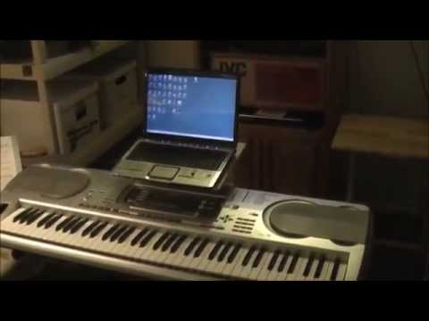 Read sheet music from laptop mounted on piano keyboard