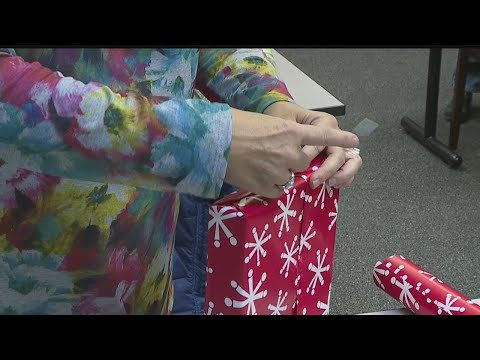 Volunteers wrap gifts for more than local 900 senior citizens
