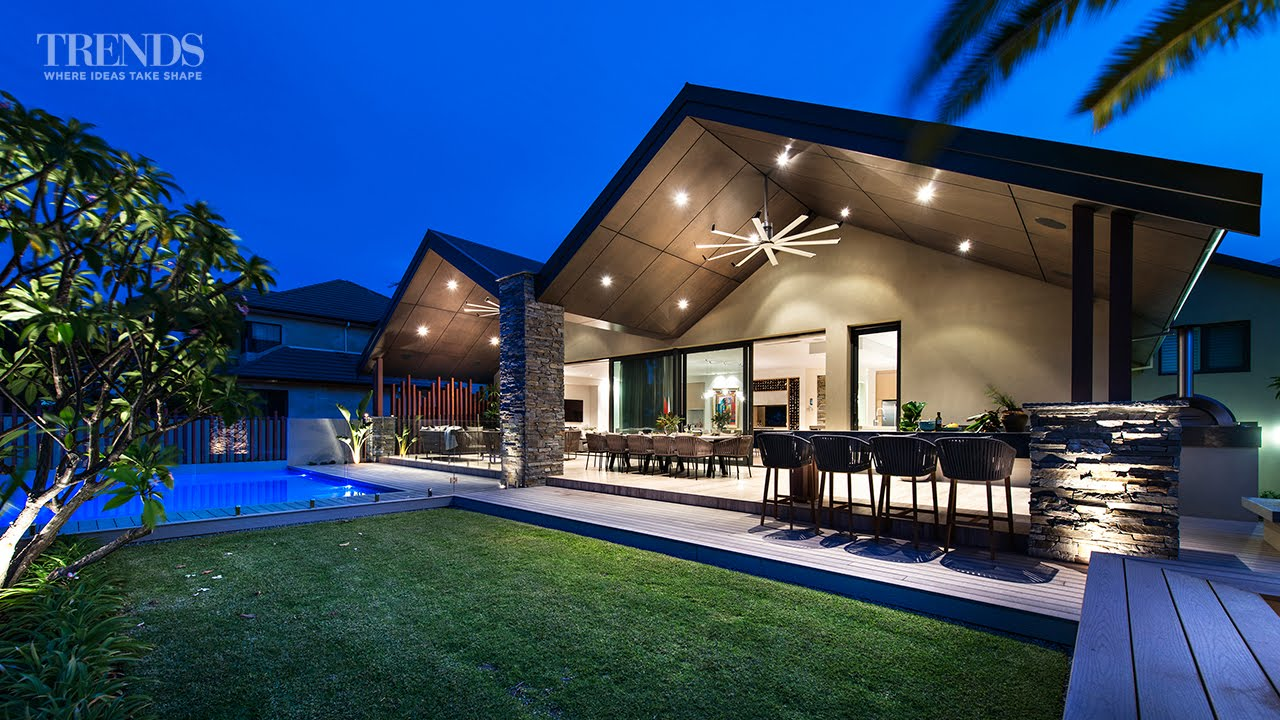Outdoor living area pool and barbecue created in