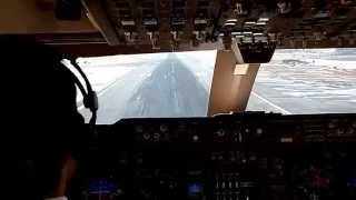 Boeing 747 400 Landing at snowy New York Kennedy airport rwy 31R.