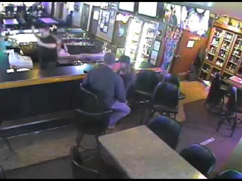 Surveillance video shows robbery at Tap Inn