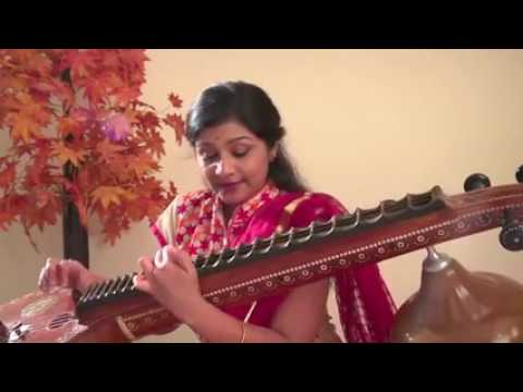 Cute Young Indian Lady Plays Veena