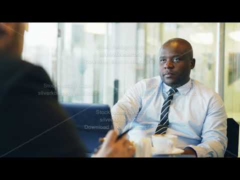 African American businessman gesticulating and explaining his startup details to investor in formal