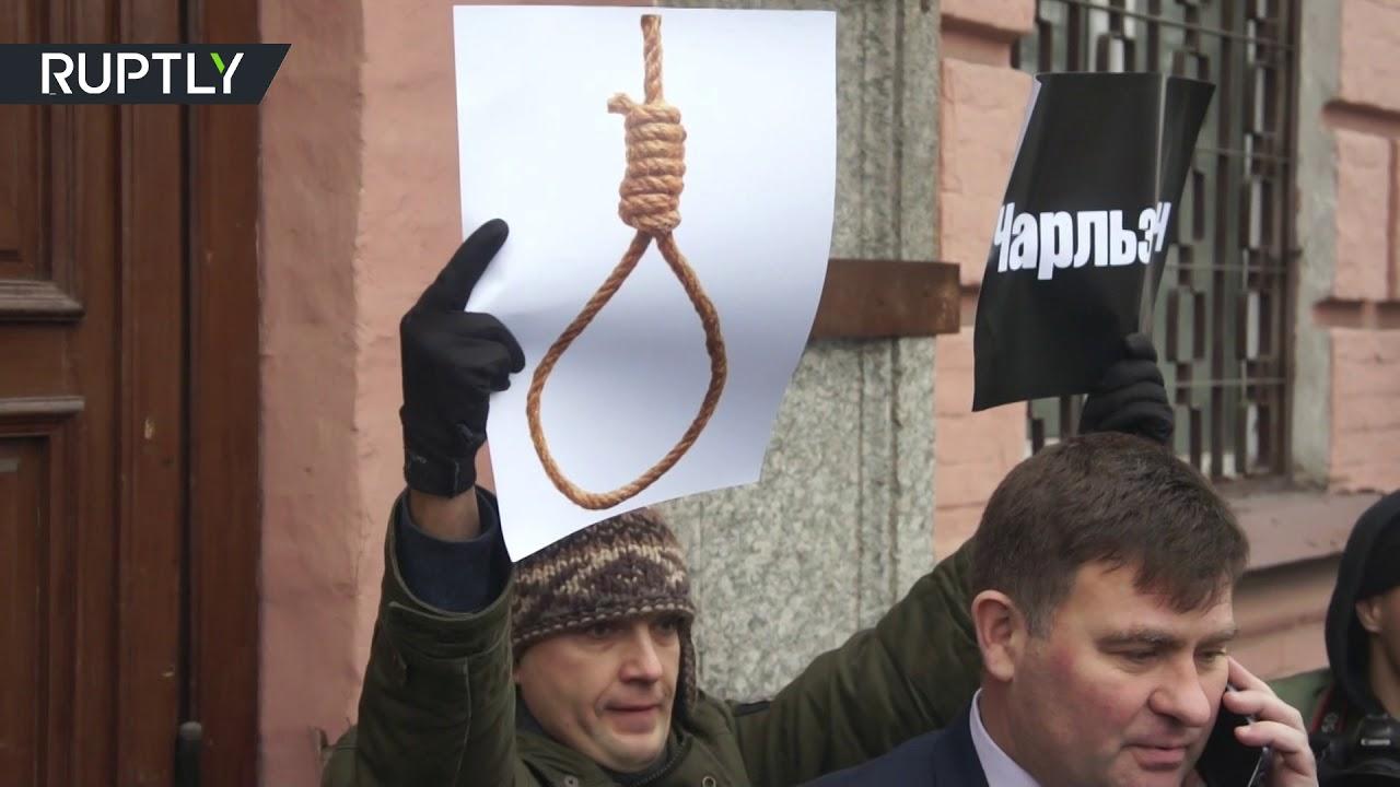 Активист напал на главу полиции Киевской области в ходе акции протеста из-за убийства правозащитницы