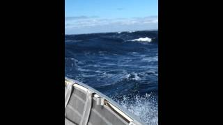 Rough ocean small boat