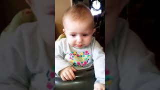 Funny baby tries a popsicle for the first time