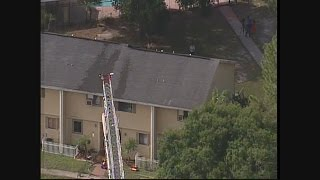 Firefighters working two-alarm fire at Land  O