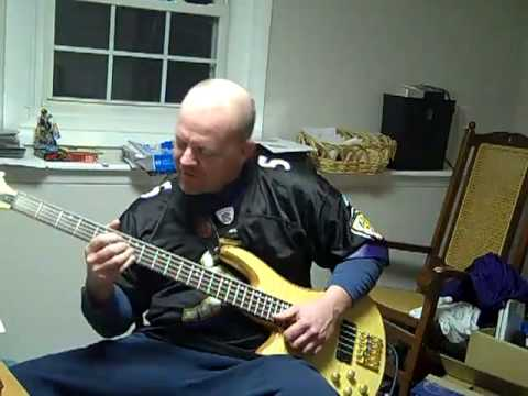 Simpsons theme and Seinfeld theme on the bass guitar