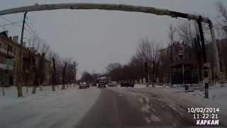 Заснеженный Ахтубинск и скользящий УАЗ